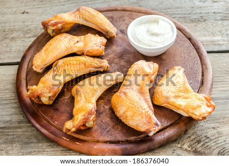 Smoked chicken wings with spicy sauce - stock photo
