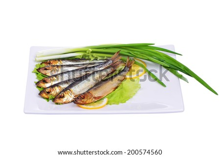 Smoked fish and salad on a plate isolated on white background - stock photo
