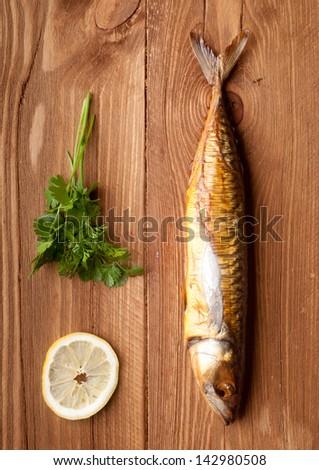smoked fish (mackerel), on board, selective focus - stock photo