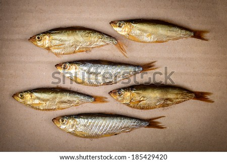 smoked fish on cardboard - stock photo