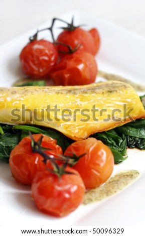 Smoked haddock with spinach and vine roast tomatoes