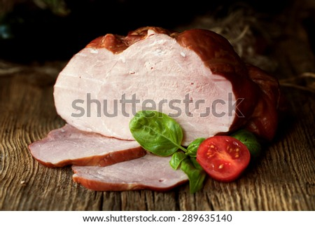Smoked ham on a chopping board. - stock photo