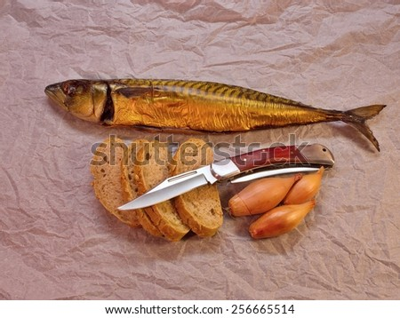 Smoked mackerel simple dish on wrapping paper - stock photo