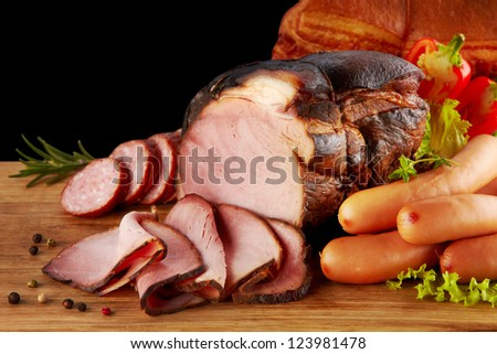 smoked meat and sausages - stock photo