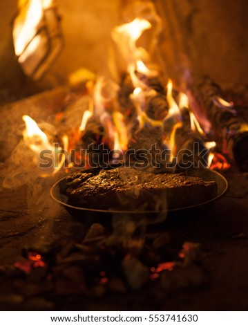 Smoked meat in the fireplace