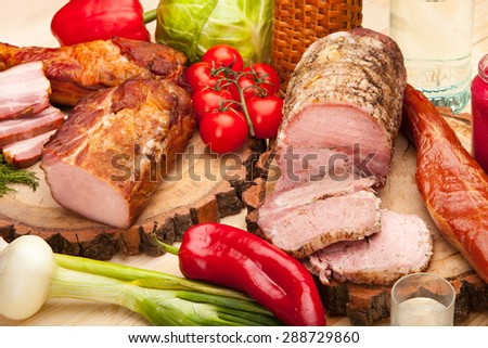 Smoked meat raw bacon with vegetables and salad