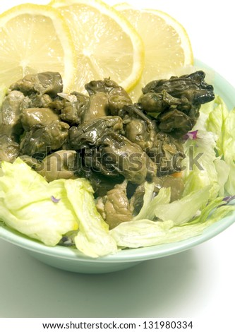 smoked oyster salad with lemon slices lettuce
