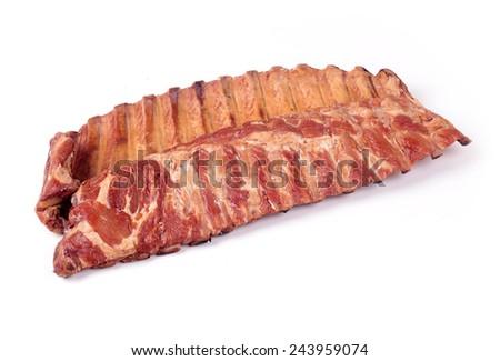 Smoked pork ribs on a white background - stock photo