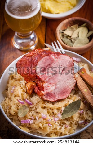 Smoked pork with cabbage (Sauerkraut) and beer - stock photo
