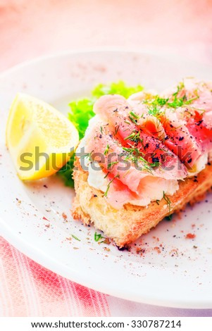 Smoked salmon and cream cheese sandwich (selective focus) - stock photo