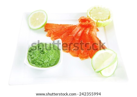 smoked salmon and green sauce on white - stock photo