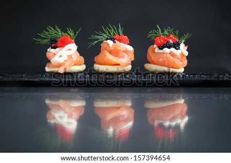 Smoked salmon canape - stock photo