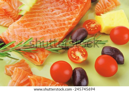 smoked salmon fillet isolated on plate with rosemary - stock photo
