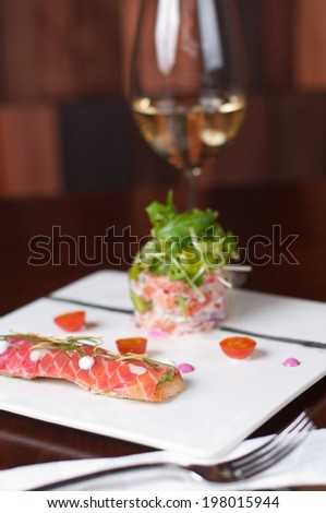 smoked salmon in two different ways on a white dish