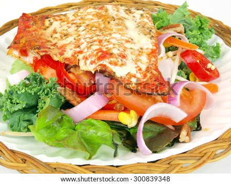 smoked salmon on salad of lettuce, tomato, onion, pepper, bean sprout, and beats - stock photo