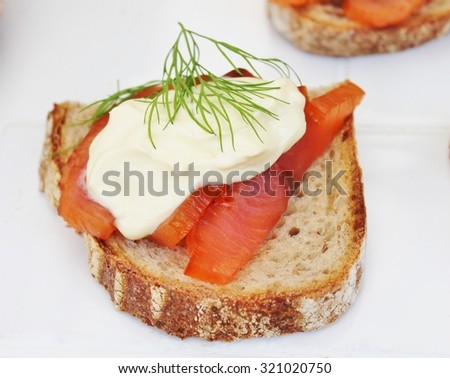 smoked salmon on toast crème fresh and dill - stock photo