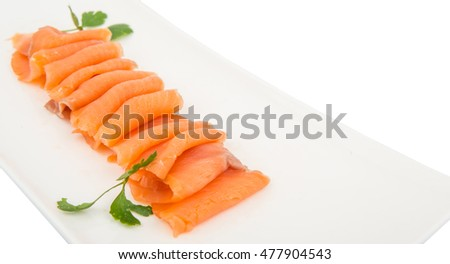 Smoked salmon pieces in white plate over white background