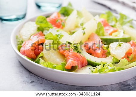 Smoked salmon salad, with mixed greens, avocado,grapefruit. Delicious healthy eating. - stock photo