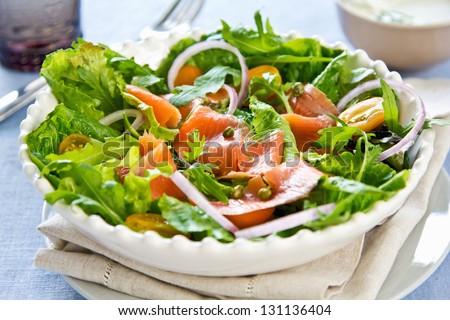 Smoked salmon salad with sour cream dressing - stock photo