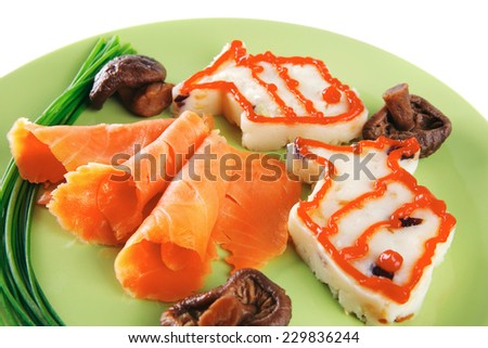 smoked salmon served with mashed potatoes on green - stock photo