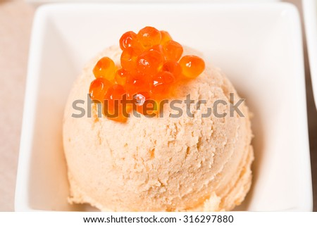 Smoked salmon terrine with red caviar closeup. Macro. Photo can be used as a whole background. - stock photo