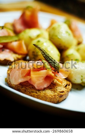 smoked salmon toasts with potatoes with dill - stock photo