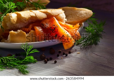 smoked salmon with bread , dill and pepper  - stock photo