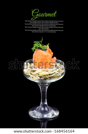 Smoked salmon with noodles and caviar, gourmet cuisine - stock photo