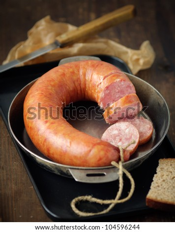 Smoked sausage in a frying pan,shallow focus - stock photo