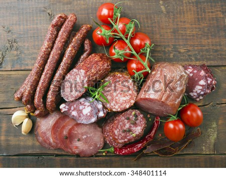 Smoked sausage with rosemary and peppercorns - stock photo