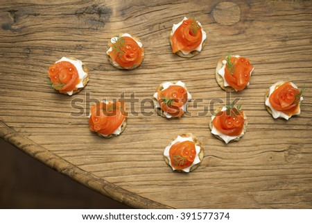 Smoked Trout Canapes with sprigs of dill and cream cheese - stock photo