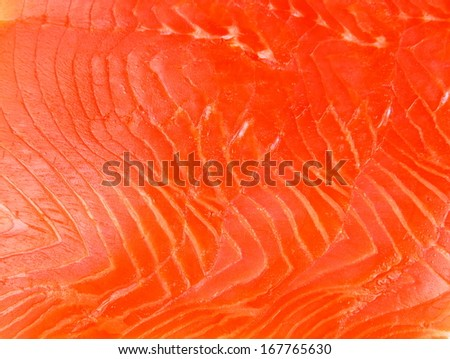 Smoked trout fillet slices as background, horizontal