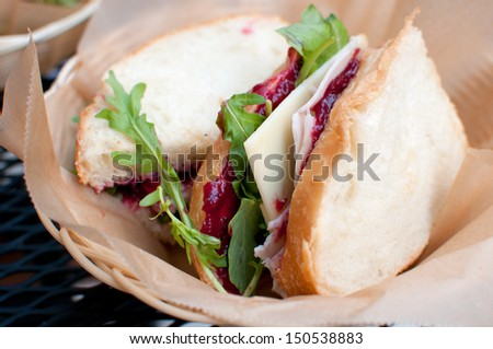 Smoked turkey and cranberry sauce sandwich with cheese