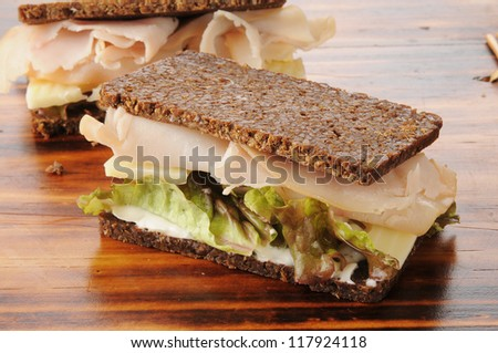 Smoked turkey or ham with swiss cheese on pumpernickel bread