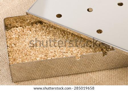 Smoker Box - Wood chips inside a metal smoking box. BBQ Time! - stock photo