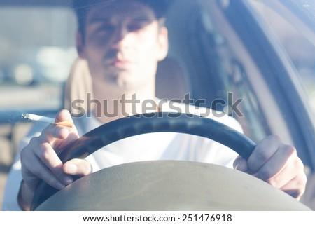 smoker driving - stock photo