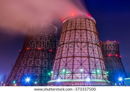 Smokestack in factory with yellow sky and clouds - stock photo
