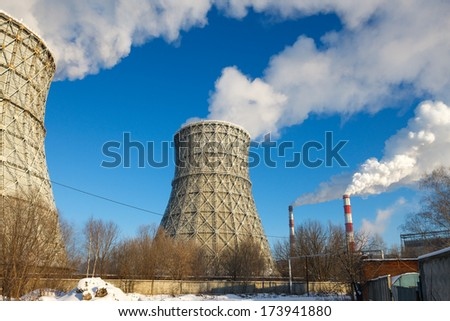 smokestack tower thermal power station in winter - stock photo