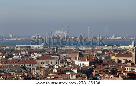 smokestacks and factories polluting with smoke near Venice in Italy - stock photo
