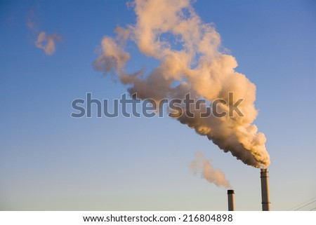 Smokestacks with trail of smoke, Berlin, Germany