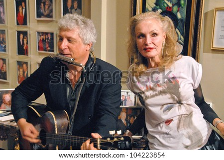 """Smokey Miles and Julie Newmar at Julie Newmar ~A Life in Motion"""" at the David  W. Streets Gallery, Beverly Hills, CA. 11-08-09 EXCLUSIVE - stock photo"""