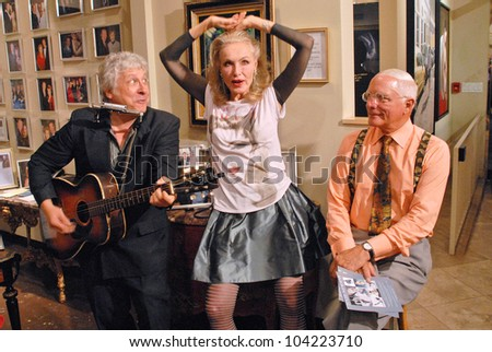 """Smokey Miles performs for Julie Newmar and her brother at Julie Newmar ~A Life in Motion"""" at the David  W. Streets Gallery, Beverly Hills, CA. 11-08-09 EXCLUSIVE - stock photo"""