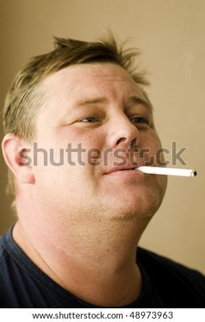 Smoking addict - stock photo