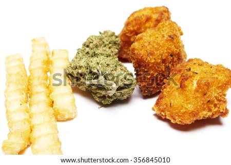 Smoking Cannabis and the Effects on the Appetite. Marijuana Bud and Fried Fast Food. - stock photo