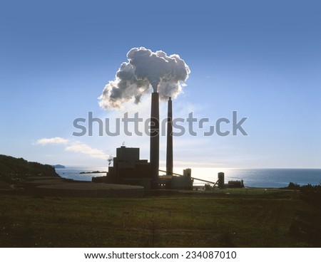 Smoking chimney in Dalhousie, New Brunswick, Canada - stock photo