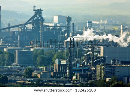 smoking chimneys in the metal industry. business park - stock photo