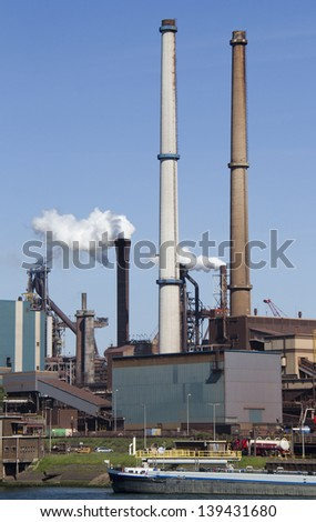 Smoking chimneys of steel industriy in IJmuiden, Holland