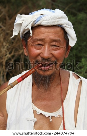Smoking Chinese Man
