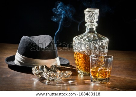 Smoking cigar and whisky with carafe - stock photo