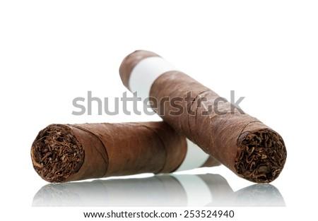 Smoking cigar isolated on white background - stock photo